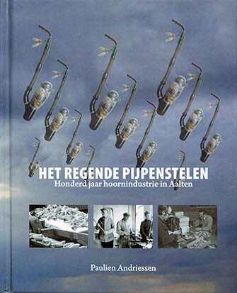 De voorkant van het boek 'Het regende pijpenstelen, honderd jaar hoornindustrie in Aalten' geschreven door Paulien Andriessen
