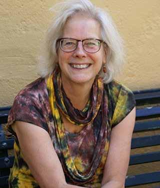 Een portretfoto van Paulien Andriessen, auteur van geschiedenis- en jeugdboeken
